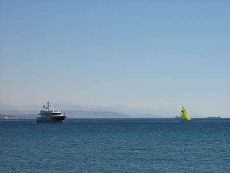 Pleasure yacht and dinghy in the Red Sea near Eilat, Israel. Stock Photo