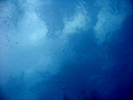An underwater photo of the clouds taken from the sea. Stock Photo