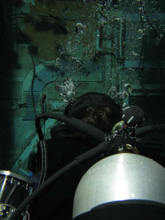 Back of diver inside a wreck. shot in the Red Sea 18102008 Stock Photo