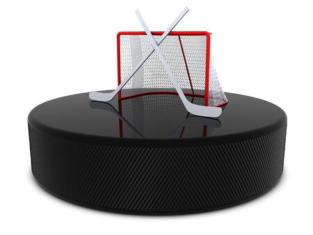 Hockey sticks and goal on the puck photo