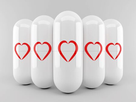 White capsules with res heart shapes in the group photo