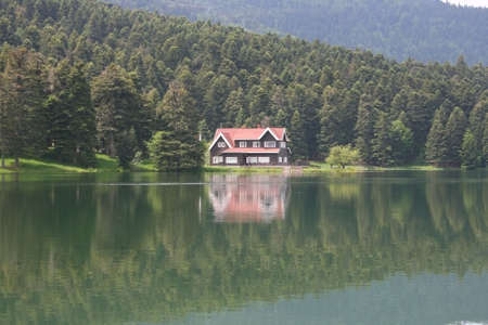 A wooden lake house in front of forest.Golcuk,Bolu,Turkey Stock Photo