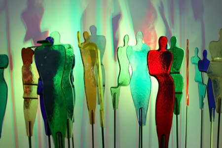 alone in crowd: Colorful people who made glass. Stock Photo
