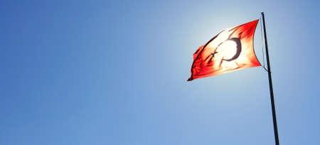 Turkish Flag And Sun Behind It