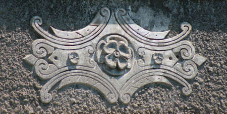 Classic stone ornament on wall of a historical house photo