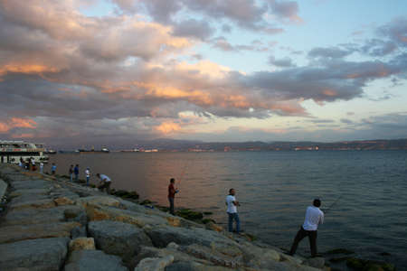 grayling: Fishermans in Eskihisar,Kocaeli,Turkey Editorial