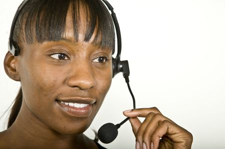 An attractive African American customer support representative, office worker or business woman. Stock Photo - 3218760