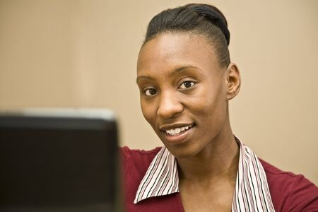An attractive African American office worker or business