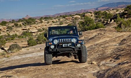 four wheel drive: Jeep On Utah Slickrock Stock Photo