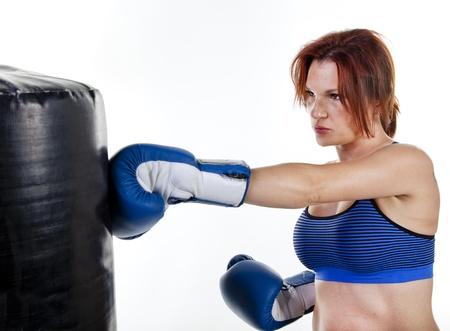 tough girl: Woman Boxer with Punching Bag Stock Photo