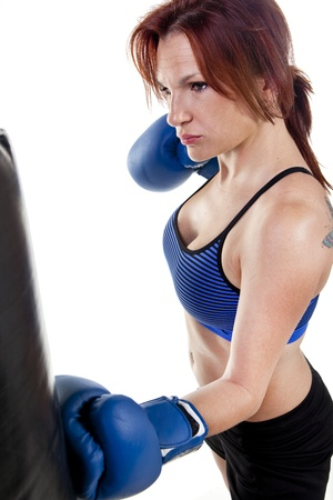 tough: Woman Boxer with Punching Bag Stock Photo