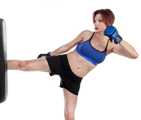 Woman Kick Boxer with Punching Bag photo