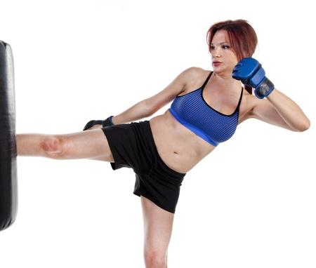 kick boxer: Woman Kick Boxer with Punching Bag