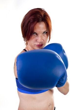 Tough woman boxer practicing boxing.