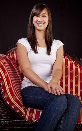 Portrait of a Teenaged Girl on Sofa Stock Photo - 11701309