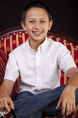 Portrait of a Teenaged Boy on Sofa photo