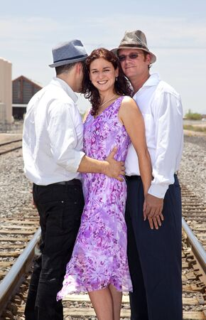 Woman with Two Men 写真素材