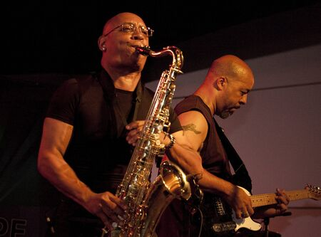 Tempe, Arizona, USA - May 29, 2010 - Alex Holland on Saxophone and Ed Davis on guitar perform at a concert by the Knee Deep Experience. Editorial