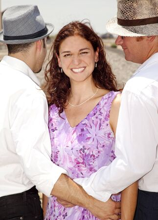 Woman with Two Men Stock Photo