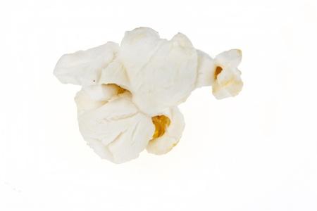 白で隔離されるポップコーン カーネル 写真素材
