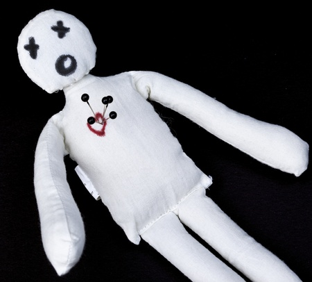 symbol victim: voodoo doll with pins in its heart