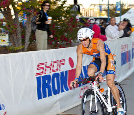 Tempe, Arizona, USA,  November 22, 2010 -   Jozsef Major racing in the cycling stage of the Phoenix Ironman Triathlon Editorial