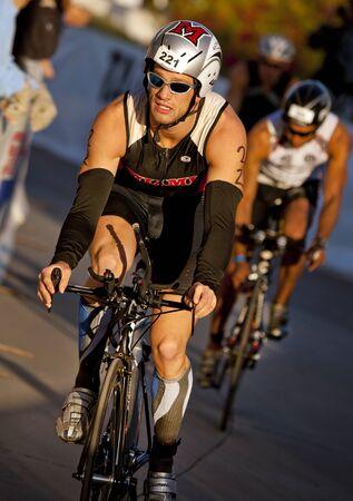 Tempe, Arizona, USA,  November 22, 2010 -  Nick Stanoszek racing in the cycling stage of the Phoenix Ironman Triathlon Imagens - 12059515