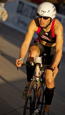 Tempe, Arizona, USA,  November 22, 2010 - Mike Hermanson  racing in the cycling stage of the Phoenix Ironman Triathlon