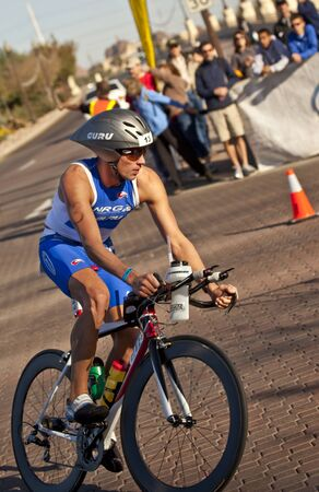 Tempe, Arizona, USA,  November 22, 2010 - Wolfgang Guembel racing in the cycling stage of the Phoenix Ironman Triathlon Editorial