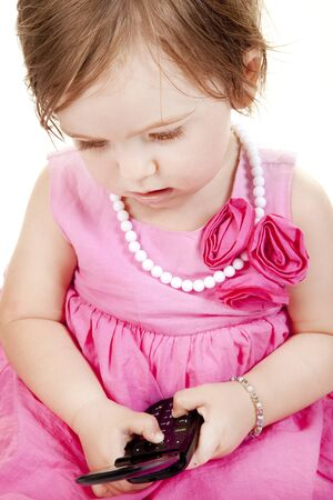 Baby Girl with Cell Phone Stock Photo