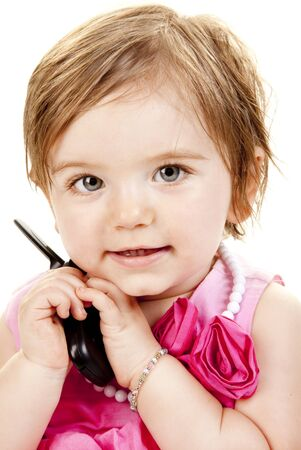 Cute Baby Girl Holding A Cell Phone photo