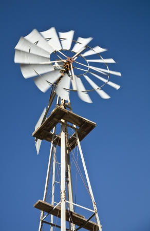Old west-style farm windmill photo