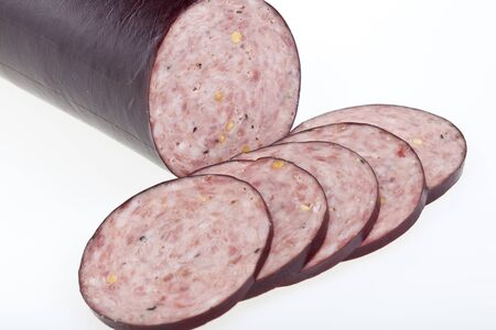 Summer sausage sliced and isolated on white