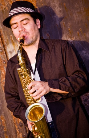 saxophonist plays outdoors Stock Photo