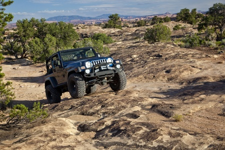 moab: Jeep On Utah Slickrock Stock Photo