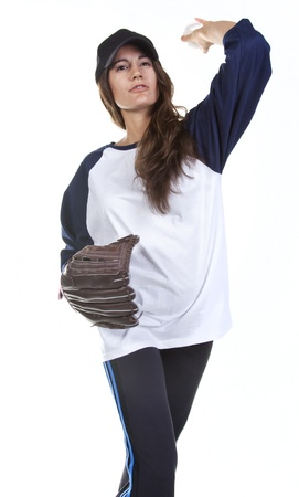 Woman Baseball or Softball Player Pitches a Ball