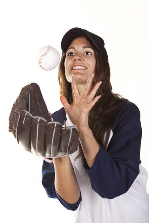 Woman Baseball or Softball Player Catches a Ball photo