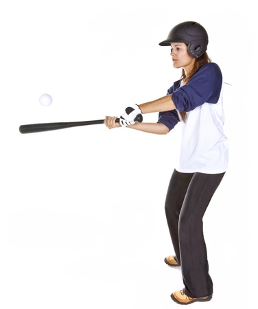 Woman Baseball or Softball Player Hits a Ball