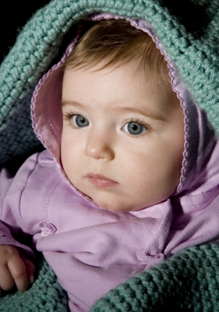 swaddled: Portrait of five month old baby swaddled in a blanket  Stock Photo