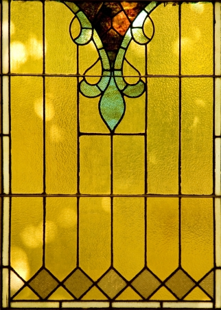 Backlit victorian-style stained glass Window. Stock Photo