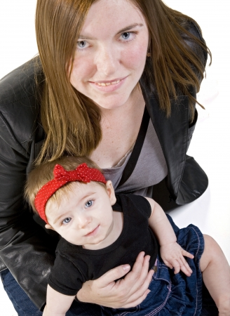 Young mother with her six-month old baby girl Stock Photo - 14158613
