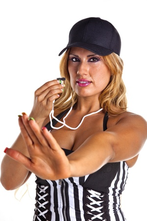 Sexy woman referee blows whistle signalling stop isolated on white  photo