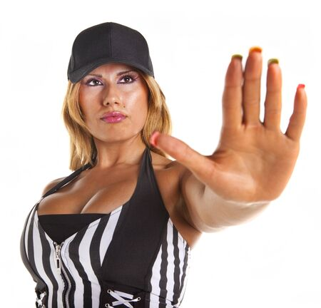 Sexy woman referee  signalling stop isolated on white