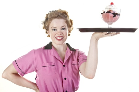Vintage style waitress or female server serving an ice cream sundae isolated on white