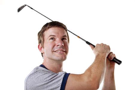 Man swinging a golf club isolated on white  免版税图像
