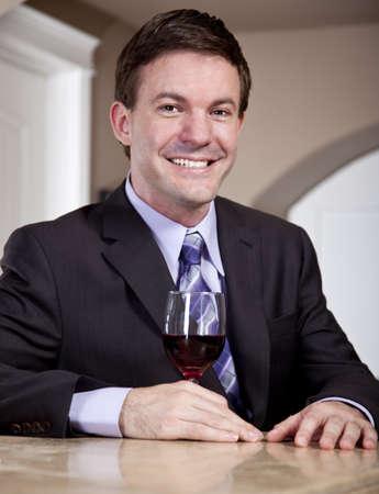 Man enjoying a Glass of Wine in a Bar