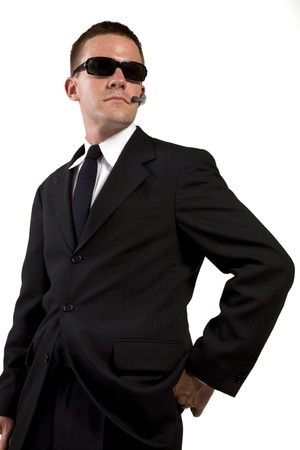 Secret Agent Reaches for Gun Stock Photo