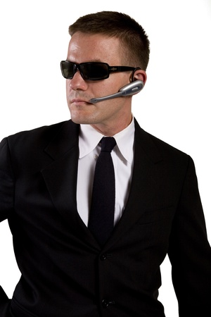 Secret Agent Reaches for Gun Stock Photo - 16638622