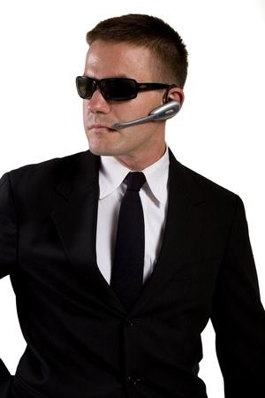 secret agent: Secret Agent Reaches for Gun Stock Photo