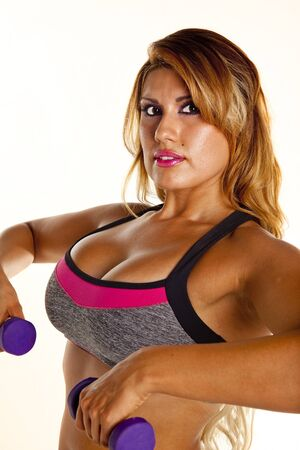 Woman exercising with dumbbell weights photo
